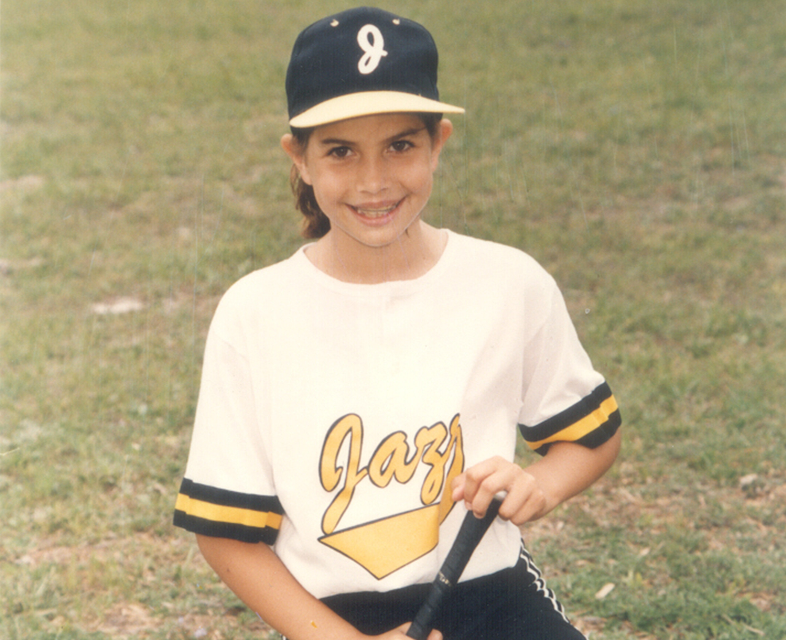 Young Cat Osterman in her Little League uniform.